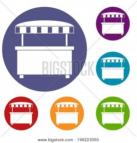 Street stall with awning icons set in flat circle red, blue and green color for web