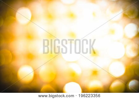 Christmas gold abstract background with bokeh defocused lights and stars.