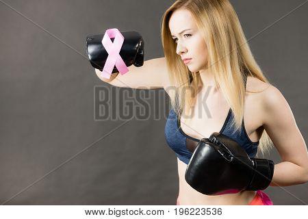 Woman Wearing Boxing Gloves Having Pink Ribbon