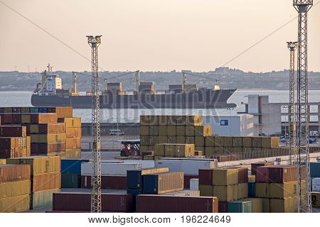 Ocean going cargo ship with containers in foreground Cadiz Spain