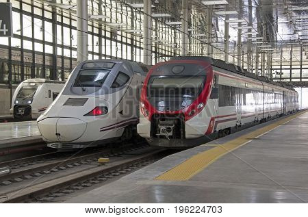 Modern passenger trains in a train station Cadiz Spain