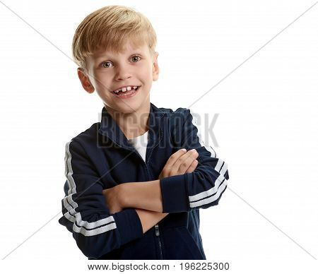 Portrait of happy smiling sporty boy with crossed hands