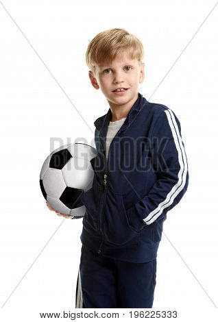 Happy little sporty boy holding soccer ball
