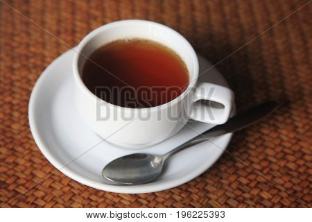 Cup Of Hot Tea On Weave Table
