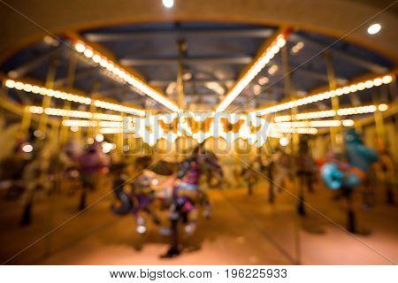 Blurred Merry Go Round In Amusement Par