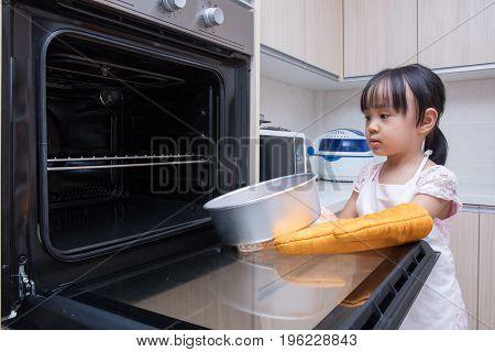 Asian Chinese Little Girl Baking Cake