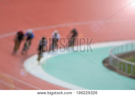 Blurred of Cyclists have a training on a velodrome.Blurred of bicyclists on cycle track outdoor,goal archive and competitive concept.