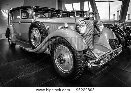 STUTTGART GERMANY- MARCH 19 2016: The car of the former German Emperor Wilhelm II Mercedes-Benz 770 Grand Mercedes convertible F 1932. Black and white. Mercedes-Benz Museum.