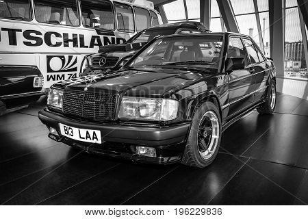 STUTTGART GERMANY- MARCH 19 2016: Compact executive car Mercedes-Benz 190E 2.3 AMG (W201) 1984. The owner of Ringo Starr (ex-musician and drummer of the Beatles). Black and white. Mercedes-Benz Museum.