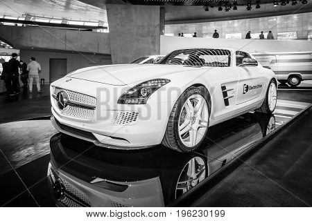 STUTTGART GERMANY- MARCH 19 2016: Luxury car Mercedes-Benz SLS AMG Coupe Electic Drive 2012. Black and white. Mercedes-Benz Museum.