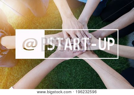 Start Up Business Concept. Businessman And Businesswoman Stacking Hand strong about cooperation.