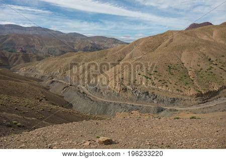 Panorama Of High Atlas Mountain Range And Serpentine Road From On Of Pass, Morocco, Africa