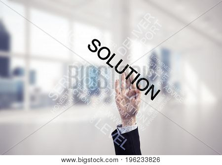 Close of businesswoman hand touching screen with business conceptual words