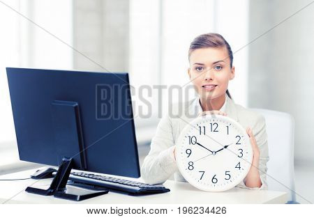 picture of attractive businesswoman with white clock