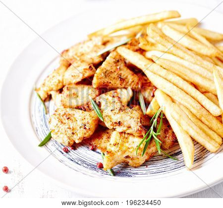 Spicy Chicken Pieces with French Fries