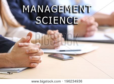 Concept of management science. People on business meeting in office, closeup