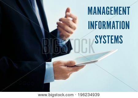 Concept of management information systems. Man holding tablet on color background, closeup