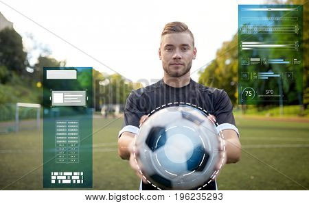 sport, football training and people - soccer player with ball on field