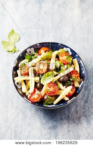 Casarecce pasta salad with cherry tomatoes and olives