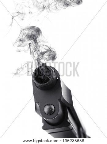 Smoking gun on white background, closeup