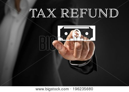 Man pointing on symbol of dollar banknote, closeup. Tax refund concept
