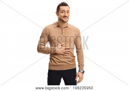 Satisfied man holding his hand on his stomach after having a meal or a drink isolated on white background poster