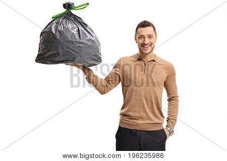 Young man holding a garbage bag isolated on white background