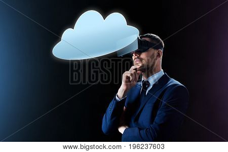 business, people, augmented reality, cyberspace and modern technology concept - businessman in virtual headset looking at cloud computing projection over black background