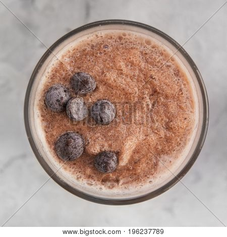 Chocolate smoothie on a white concrete background. Square cropping
