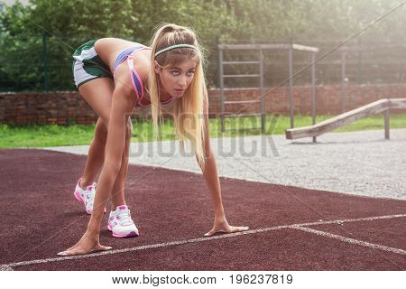 A young beauty athletic woman in sportswear preparing for running at outdoor early morning. Healthy lifestyle.