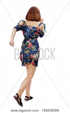 back view of running  woman. beautiful girl in motion. backside view of person.  Rear view people collection. Isolated over white background. A girl in a dress in a flower rushes into the distance