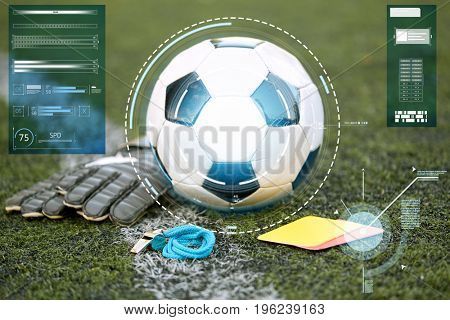 sport, soccer and technology concept - ball, goalkeeper gloves, referee whistle and caution card on football field