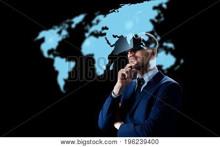 business, people, augmented reality and modern technology concept - businessman in virtual headset looking at world map projection over black background