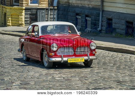 Lviv Ukraine - June 4 2017: Old retro car VOLVO AMAZON 121 with its owner and au unknown passengers taking participation in race Leopolis grand prix 2017 Ukraine.