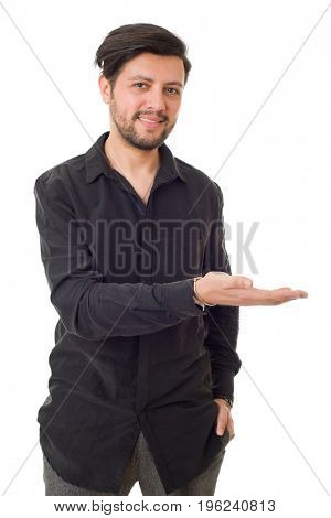 friendly young man pointing to his side and looking into the camera. isolated on white background