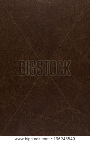 vertical dark brown leather background with creased