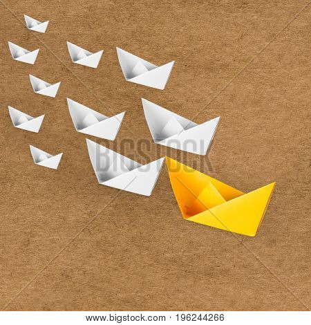 leadership concept with yellow paper boat as a leader