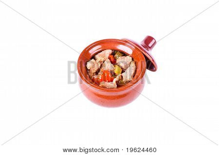 Meat in a pot with vegetables