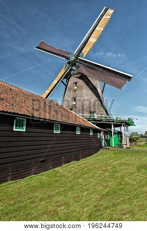 Fully Operational Historic Dutch Windmill in Zaanse Schans on the Zaan River in the Netherlands