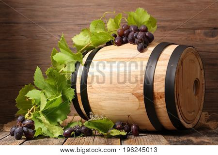 wooden barrel with grape and leaf