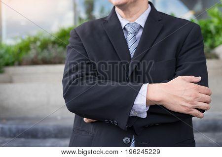 Confident handsome businessman in outdoor concept .