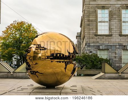 The Sphere Within Sphere, Sculpture Of The Italian Sculptor Arnaldo Pomodoro.trinity College, Dublin