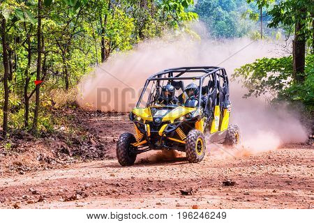 CHIANG MAI THAILAND - MAY 03: Undefined Driver on Side-by-Side Vehicles (UTV) on countryside roads May 03 2015 in Chiang mai Thailand.