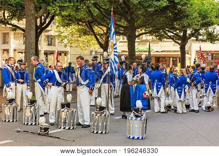 Zurich, Switzerland - 1 August, 2016: participants of the parade devoted to the Swiss National Day. The Swiss National Day is the national holiday of Switzerland, celebrated on 1 August.
