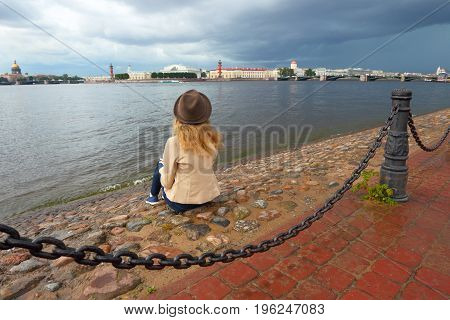 Saint-Petersburg.Russia.Girl dreams in the city.The sights of the historic centre of Saint Petersburg.