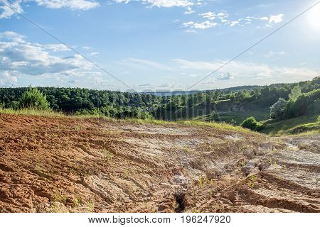 Landscape with the image of a clay quarry