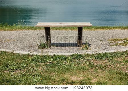 little wooden bench at lake and relax