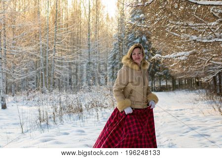 Woman In The Forest In A Winter Day