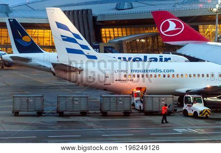 MOSCOW, RUSSIA, JULY 09, 2017: Airplanes boarding at Vnukovo International airport during sunrise