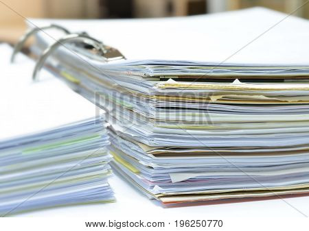 Pile of papers and documents in document file on white table at workplace,business concept,office supplies.